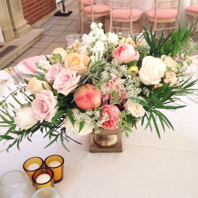 Centerpieces with roses, feathery greens--and peaches! #summerwedding